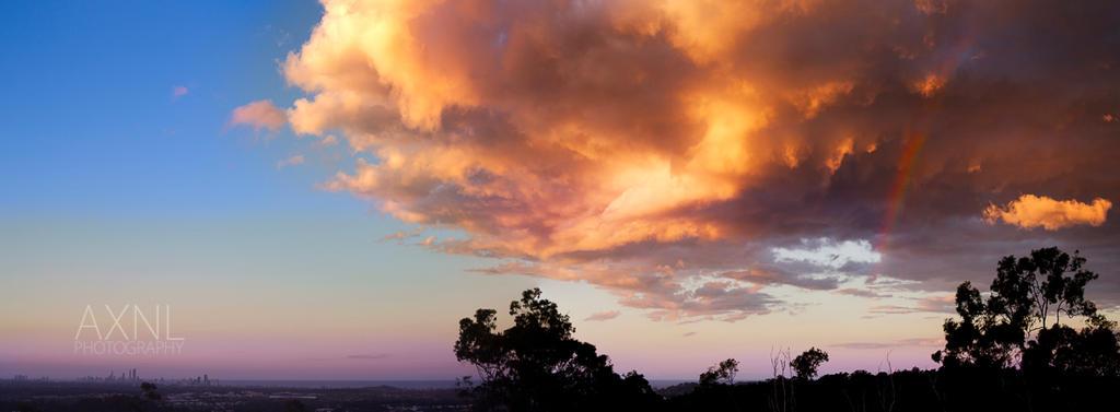 Rainbow Sunset by AXNLphotography