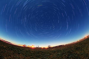 star trails on a moon lit night by twombold