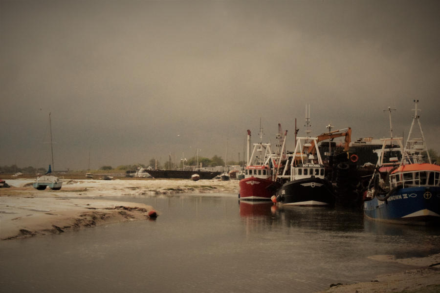 Cockle Boats Moored At Low Tide