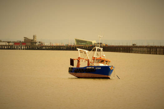 A Fishing Boat At Low Tide