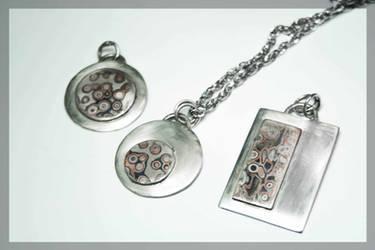Mokume gane pendants by BichoBolita