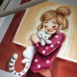 Girl hugging cat