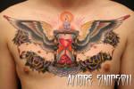 Hourglass chest tattoo