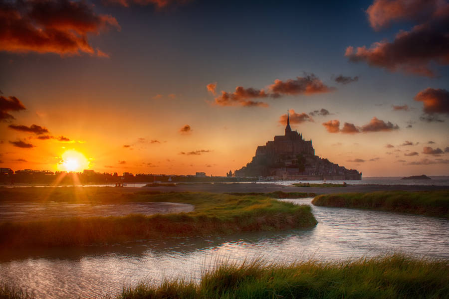 Sunset at Le Mont St. Michel by melintir