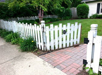 The House with the White Picket Fence