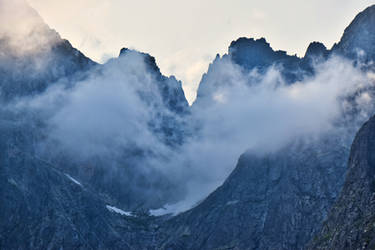 Mountain peaks hiding under evening clouds I