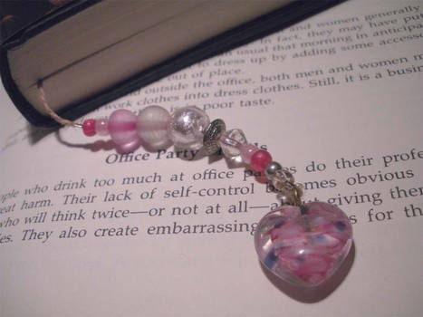 Pink and Silver Beads with a Pink Heart on Brown