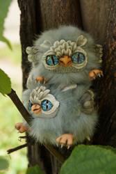 Owl on owl's head by KrafiCat