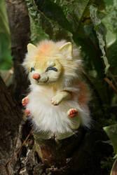 Yunmei Mirai toy sitting on a tree stump by KrafiCat