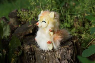 Yunmei Mirai toy nyan sitting on a tree stump by KrafiCat