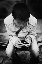 Boy playing with his iPod