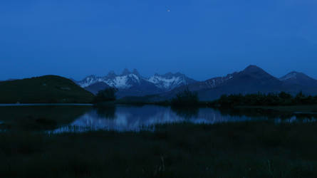 Small mountain lake at night by rollarius55