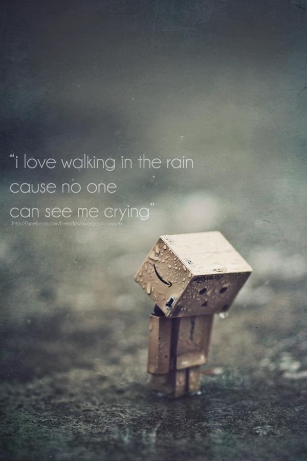 Sad Man Walking In Rain