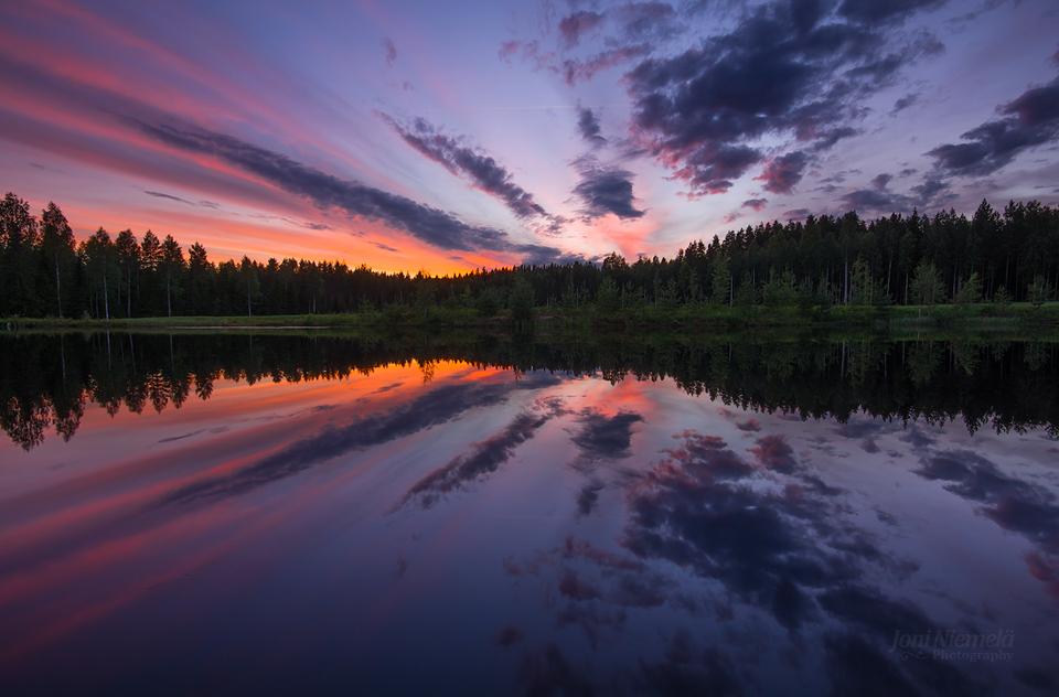 Reflection On Salmon Pond by JoniNiemela