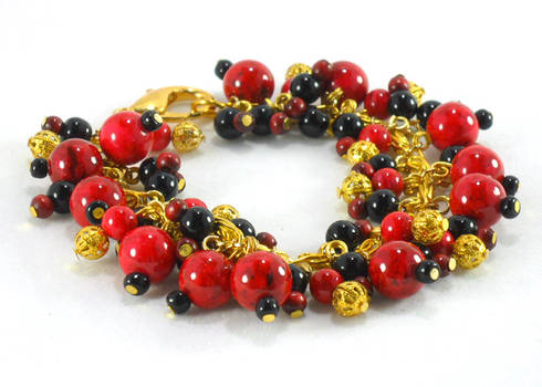 Red black and gold beaded charm bracelet