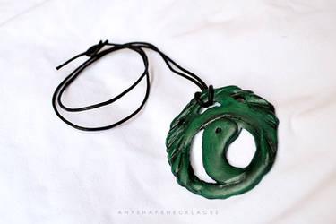 Lara Croft Tomb Raider necklace by AnyShapeNecklaces