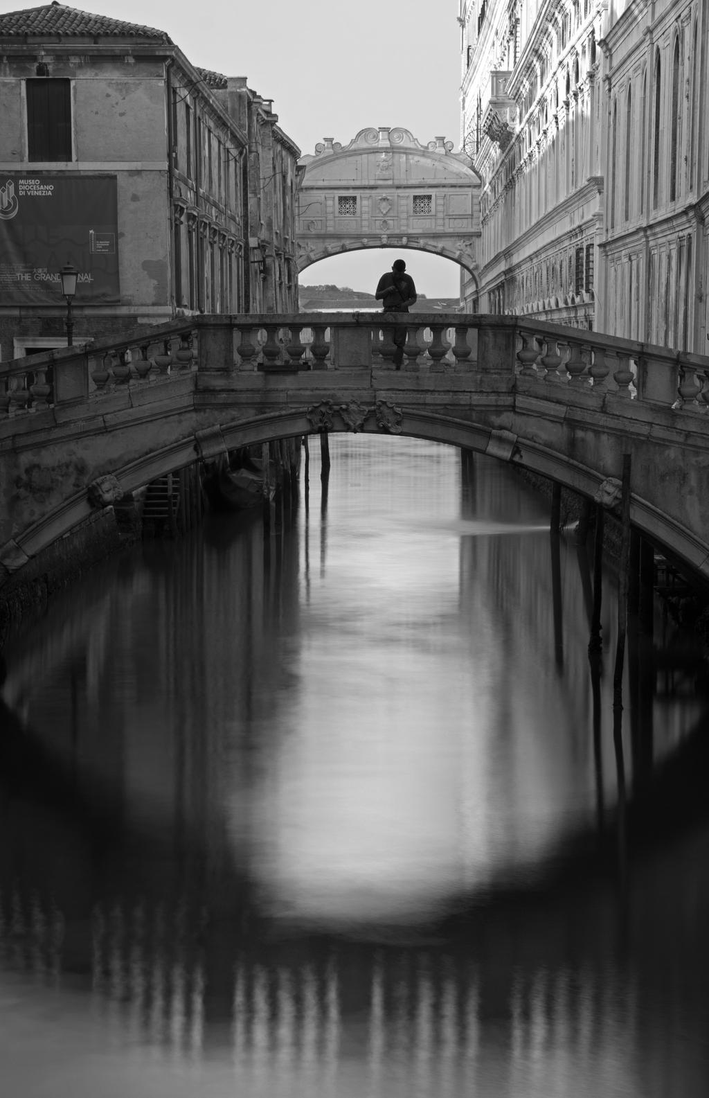 Man Under Bridge of Sighs BW by Camel51