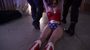 wonder woman has lost conciousness...helpless