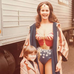 Sexy Wonder Woman with a lucky kid..looking hot