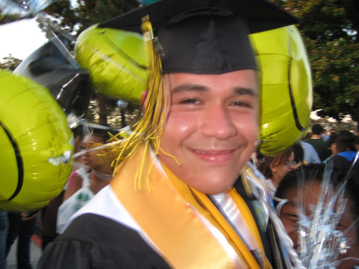 Jonathan at graduation by OhsnapItsMchle