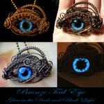 Teal Glow In The Dark Dragon Eye Pendant - Wire