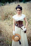 Corseted steampunk lady in field