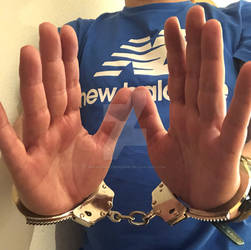 Boy showing his cuffed hands. by SneakerBoyBondage