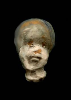 botched doll head