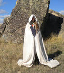 Pale Cloaked Figure