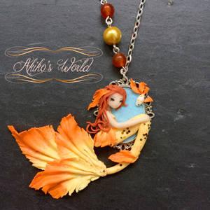 Gold and orange chibi mermaid cameo