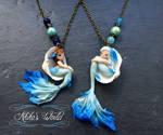 Blue mermaids in their seashells - necklace