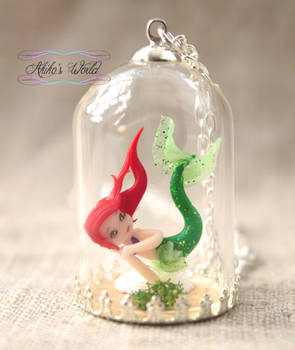 Tiny Ariel under a glass dome - The little mermaid