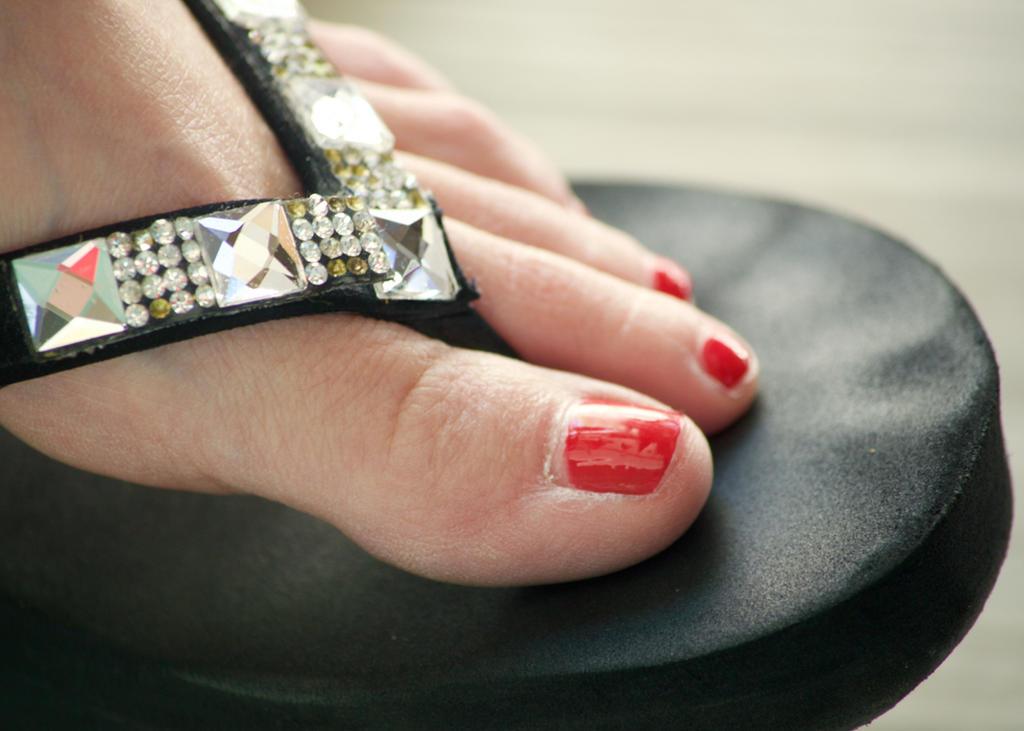 Consider, Black women feet in flip flops toenails