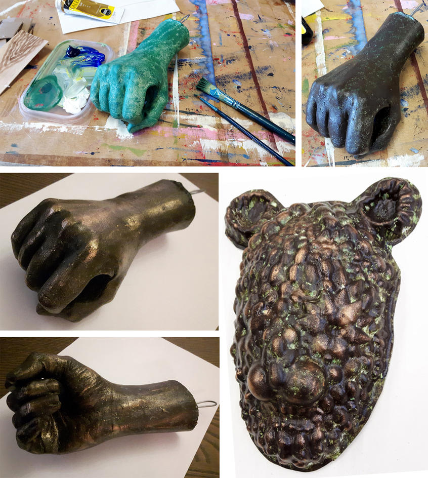 Bronze statue hand and mask by Dinogomonni