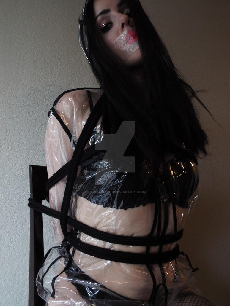 Tangled Angel bound in raincoat by lilnikkibound