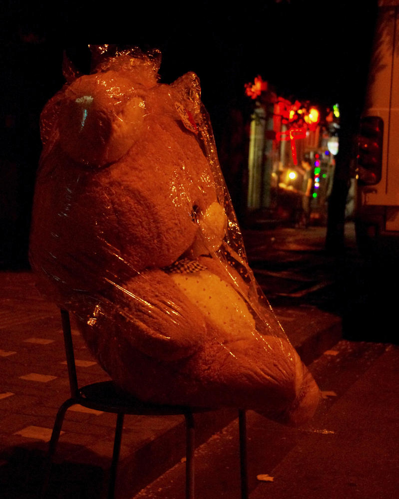 Bear on a chair in plastic wrap by 0olong