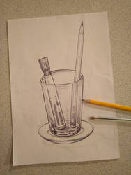 Glass cup and pens