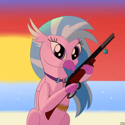 Silverstream Holding a Rifle in Front of a Sunset