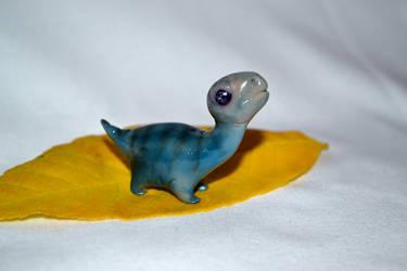 Little dino by SandBasilisk
