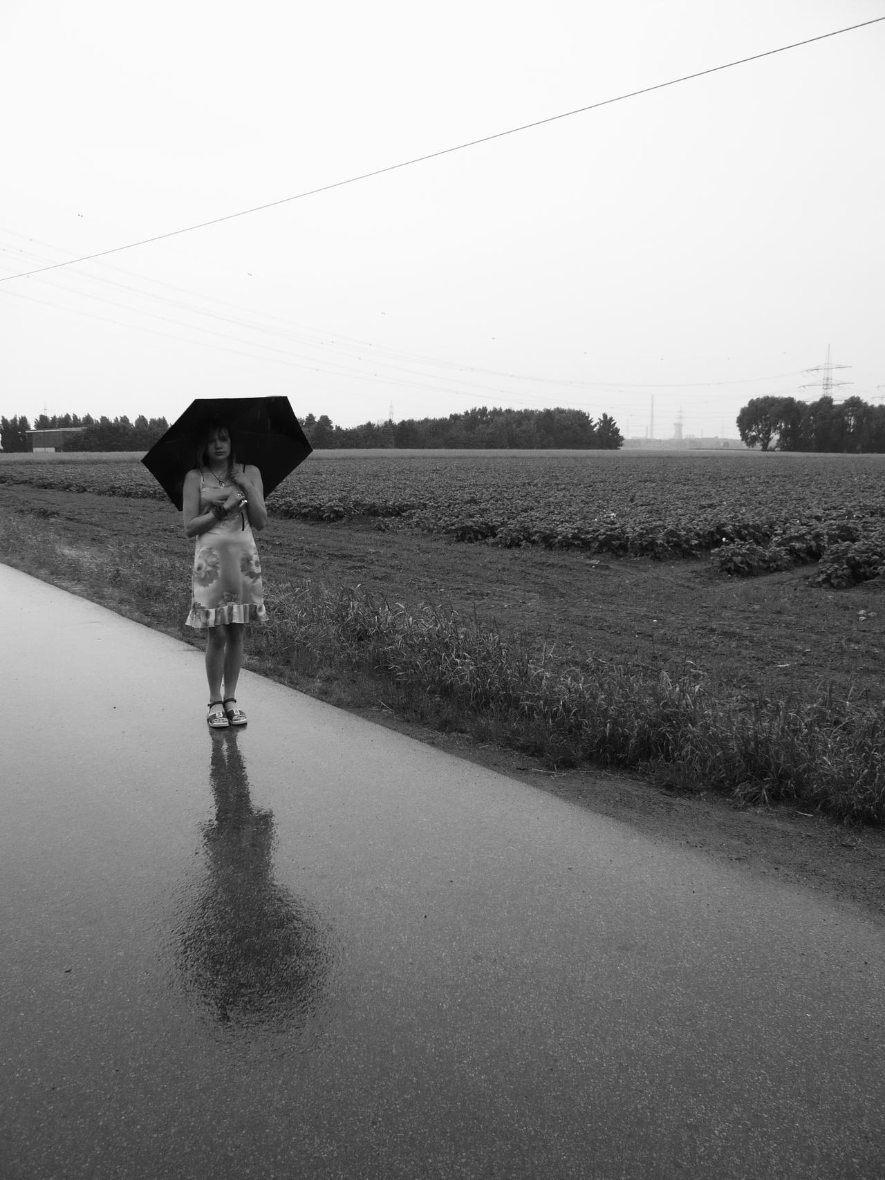 Standing Alone In The Rain