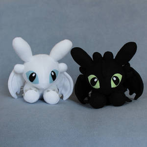 Laying Down Night and Light Fury Plushies