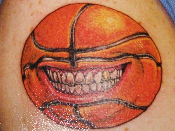 grinning basketball tat