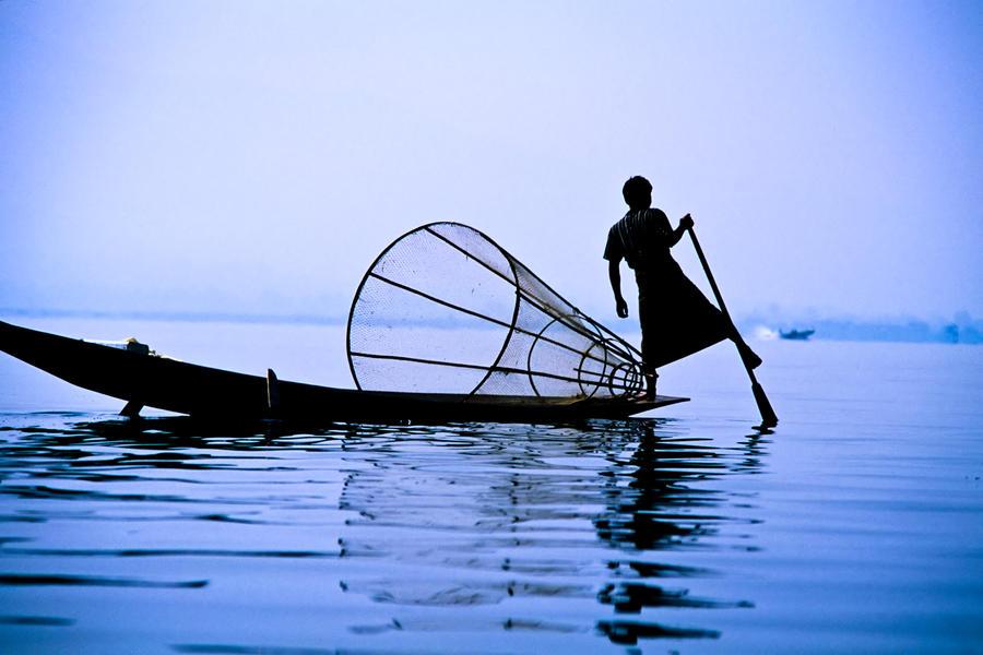 Fishing boat on Lake Inle by ingojez