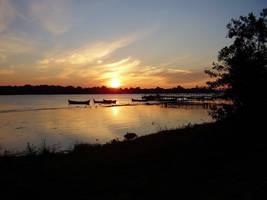 Fishing boats at sunset by iulikamd