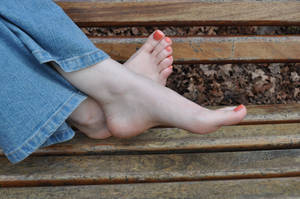 Ankles Crossed on Bench by Foxy-Feet