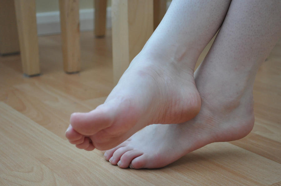 Sexy pedicured feet in ankle warmers 7
