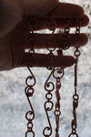Necklaces in frozen window by MoxieBlacksmith