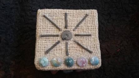 Small tarot box pic #2-top view stones  sun