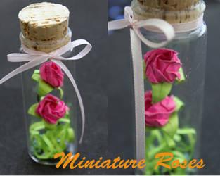 Mini origami roses in a bottle by CakeFruit