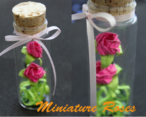 Mini origami roses in a bottle by CakeFruit